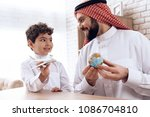 father arab tells son about...   Shutterstock . vector #1086704810