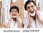 portrait of father and son with ... | Shutterstock . vector #1086709499