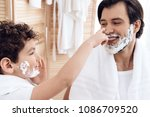 little son spoils father's nose ... | Shutterstock . vector #1086709520