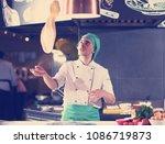 skilled chef preparing dough... | Shutterstock . vector #1086719873
