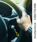 Small photo of A hand pushes the cruise control button on a steering wheel