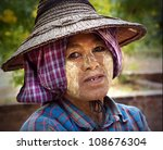 BAGAN, MYANMAR - NOV 17: An unidentified woman is wearing Tanaka on Nov 17, 2011 in Bagan, Myanmar. It is a traditional whitening secret adored by females in Myanmar for more than 2000 years . - stock photo