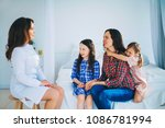 little girls trust a young... | Shutterstock . vector #1086781994