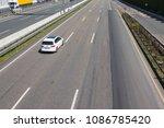 car is driving constantly left...   Shutterstock . vector #1086785420