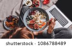 woman in home clothes eating... | Shutterstock . vector #1086788489