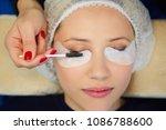 young model applying mascara.... | Shutterstock . vector #1086788600