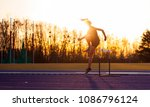 athletic woman jumping above... | Shutterstock . vector #1086796124