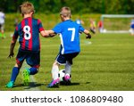 two young soccer players... | Shutterstock . vector #1086809480