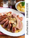 Small photo of Choucroute garnie. Alsatian sauerkraut with sausages, knuckle and bacon