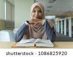 a beautiful muslimah student... | Shutterstock . vector #1086825920
