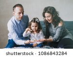 young family. happy family.... | Shutterstock . vector #1086843284
