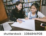 asian students reading books in ... | Shutterstock . vector #1086846908