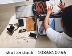 businessman packing clothes in... | Shutterstock . vector #1086850766