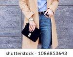 trendy woman in stylish beige... | Shutterstock . vector #1086853643