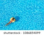 slim woman floating on air ring ... | Shutterstock . vector #1086854099