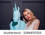 freaky blonde girl and unicorn... | Shutterstock . vector #1086855203