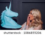 freaky blonde girl and unicorn... | Shutterstock . vector #1086855206
