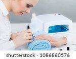 closeup of beautician painting... | Shutterstock . vector #1086860576