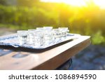 grapes spirits glasses on metal ... | Shutterstock . vector #1086894590