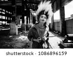 Young beautiful girl with windy hair. Black and white street photography