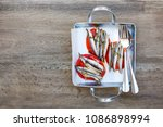 grilled sardines and tomato on... | Shutterstock . vector #1086898994