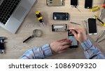repair specialists upgrading...   Shutterstock . vector #1086909320