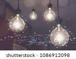 light bulb hanging on the... | Shutterstock . vector #1086912098