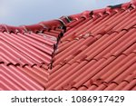 the red roof was damaged by the ... | Shutterstock . vector #1086917429