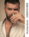 Small photo of Bearded hipster drink water. Water consumption concept. Thirst, dryness, drought. Health diet healthy dieting