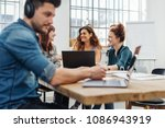 group of young people working... | Shutterstock . vector #1086943919