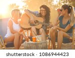 group of young female friends... | Shutterstock . vector #1086944423