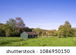 solitary rural building in a... | Shutterstock . vector #1086950150
