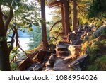 Ice age hiking trail and stone stairs in sunlight during sunset hours. Devil