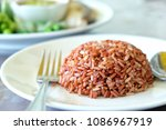 organic brown rice in dish  a...   Shutterstock . vector #1086967919