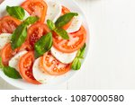 close up photo of caprese salad ... | Shutterstock . vector #1087000580