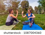 two beautiful women practicing... | Shutterstock . vector #1087004360