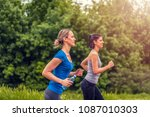 two beautiful young fitness... | Shutterstock . vector #1087010303