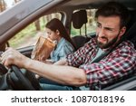 couple is driving in car. girl... | Shutterstock . vector #1087018196