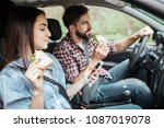 girl and guy are riding in car. ... | Shutterstock . vector #1087019078