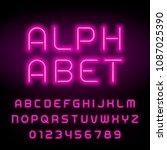 pink neon tube alphabet font.... | Shutterstock .eps vector #1087025390