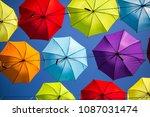 colorful umbrellas background.... | Shutterstock . vector #1087031474
