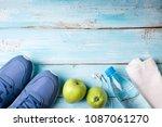 flat lay sport shoes  bottle of ... | Shutterstock . vector #1087061270
