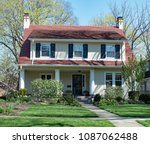 white stucco house with red... | Shutterstock . vector #1087062488