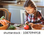 child girl helps mom to cook... | Shutterstock . vector #1087094918