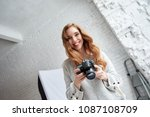Cheerful Young Photographer...