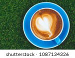 hot cappuccino in blue glass on ...   Shutterstock . vector #1087134326