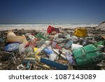 a beach completely polluted by... | Shutterstock . vector #1087143089
