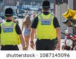 two policemen of different... | Shutterstock . vector #1087145096