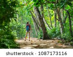 young woman hiker stands in the ... | Shutterstock . vector #1087173116