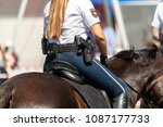 German police horsewoman rides...